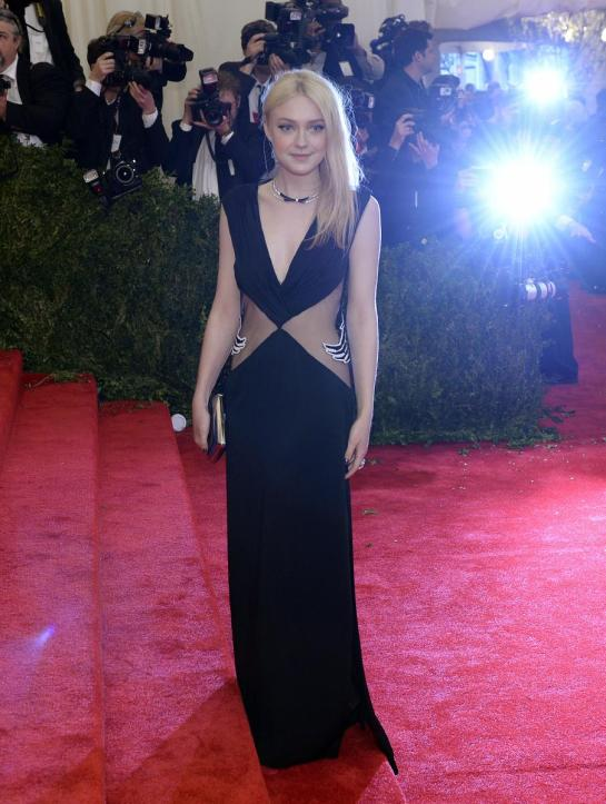The older Fanning sister Dakota prevails in a sexy peek-a-boo Rodarte number