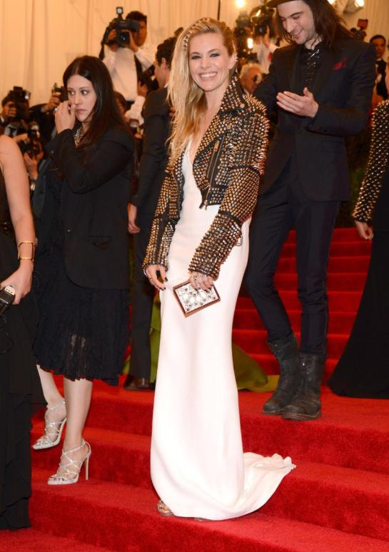 Sienna Miller perfectly combined sexy femininity with a badass rocker edge in a white Burberry gown and a cropped studded moto jacket