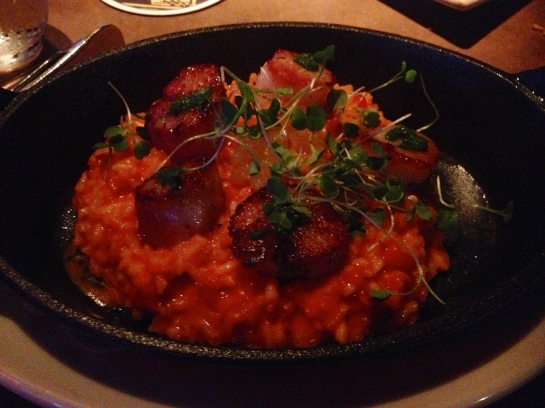 My red pepper risotto topped with seared scallops, micro arugula and tangerines. Simply delectable.