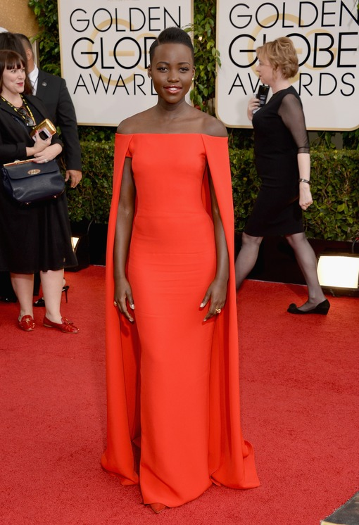 Nyong'o stuns in a bright red Ralph Lauren caped gown at the Golden Globes