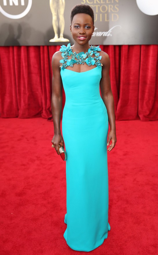 Lupita at the SAG Awards in a bright turquoise Gucci gown with floral accents