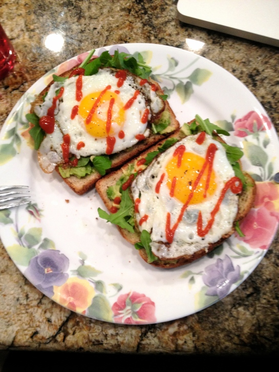 Breakfast from this morning: oats & nuts toast topped with avocados, arugula, fried eggs and sriracha.