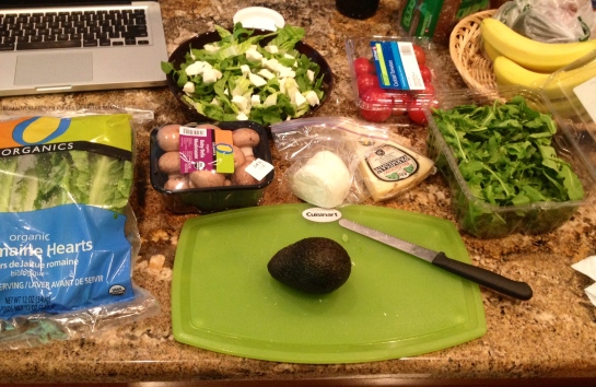 Prep for lunch: ingredients for my super salad include romaine lettuce, arugula, mushrooms, fresh mozzarella, tomatoes, avocados, topped with olive oil, balsamic glaze and parmesan.