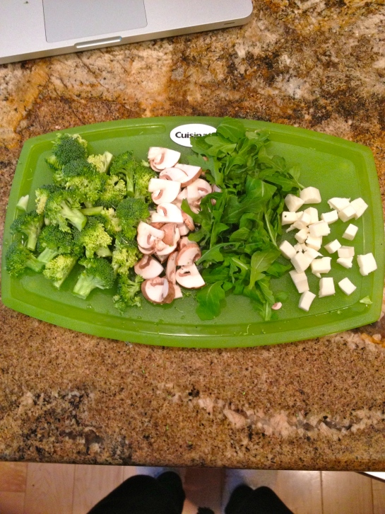 Prep for dinner: broccoli, mushrooms, arugula, and fresh mozzarella.