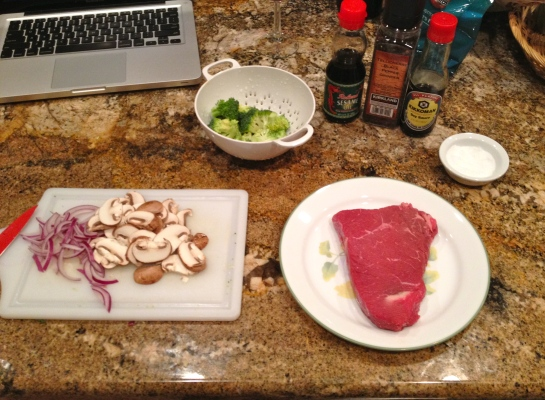A sirloin steak that I grilled with a side of asian style stir fry with broccoli, red onions, mushrooms, garlic, flavored with soy sauce and sesame oil