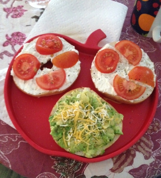 Brunch from the other day: bagels with cream cheese and tomatoes and a bagel topped with avocados and cheese.