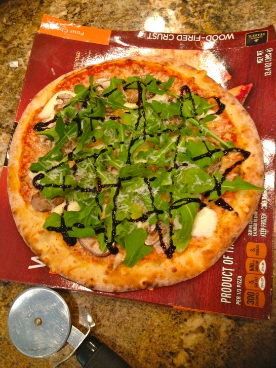 Lunch from today: took a four cheese frozen pizza from safeway and added fresh slices of mozzarella, mushrooms, parmesan, and topped it off with some arugula and you guessed it; balsamic glaze.