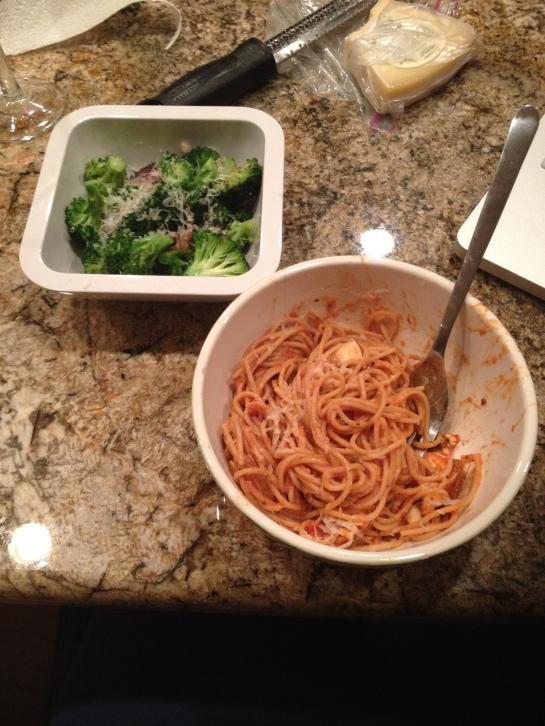 Broccoli and some spaghetti with  mushrooms and artichoke pesto tomato sauce