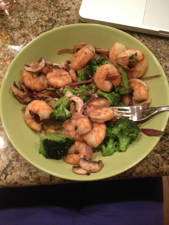 Asian shrimp and broccoli stir fry with soy sauce and sesame oil, garlic, onions, and mushrooms