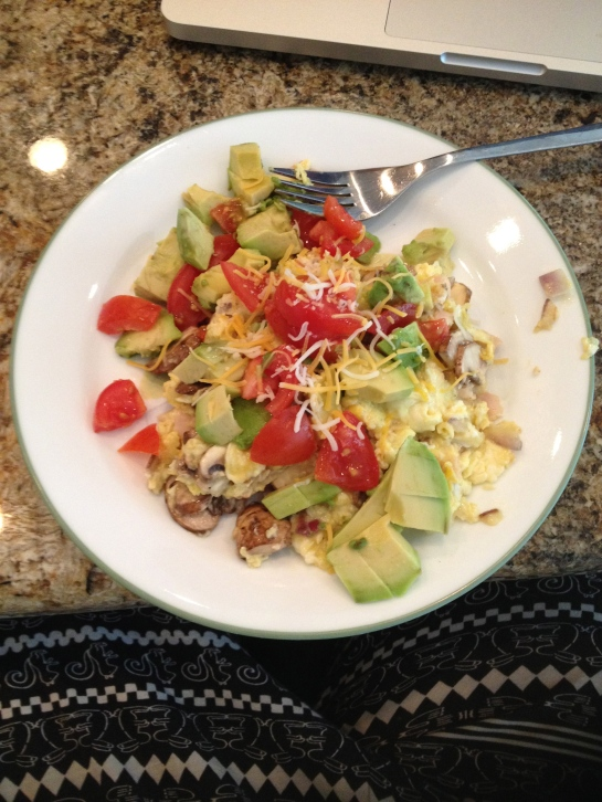 Breakfast: scrambled eggs with fresh avocados, mushrooms, onions, tomatoes and topped with some cheese