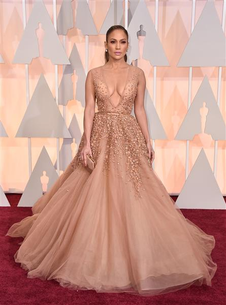Jennifer Lopez showed off her enviable physique in a tan Elie Saab gown
